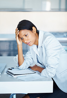 Buy stock photo View of business woman sitting at desk with hand on head