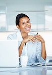 Happy Business woman next to laptop