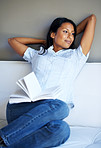 Attractive woman taking break from reading book