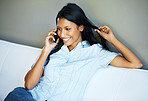 Happy woman having phone conversation