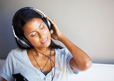Buy stock photo View of pretty woman listening to headphones with eyes closed - copyspace