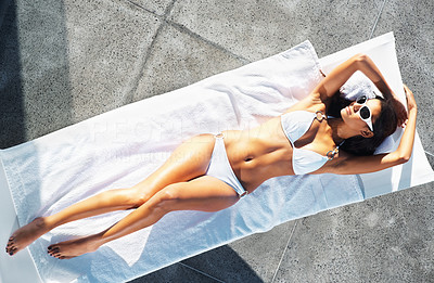 Buy stock photo Top view of woman lying on chair outdoors and sunbathing
