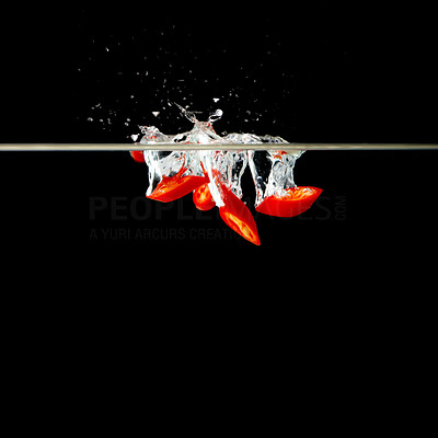 Buy stock photo Bunch of chili peppers underwater against black background