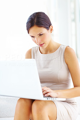Buy stock photo Portrait of cute young businesswoman sitting on steps and using laptop