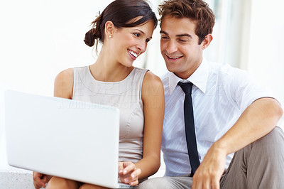 Buy stock photo Smart male business executive sitting with his girlfriend using laptop