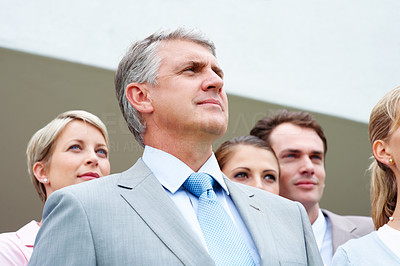 Buy stock photo Closeup of business man with his team looking away