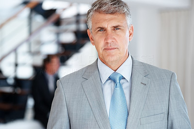 Buy stock photo Portrait of a confident mature businessman standing in the office - Indoor