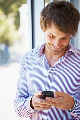 Buy stock photo Happy business man reading text message on cell phone