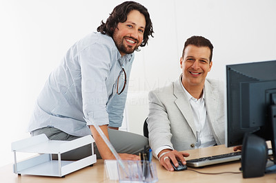 Buy stock photo Smiling business men working together at office