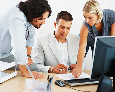 Buy stock photo Three executive working on business document at office