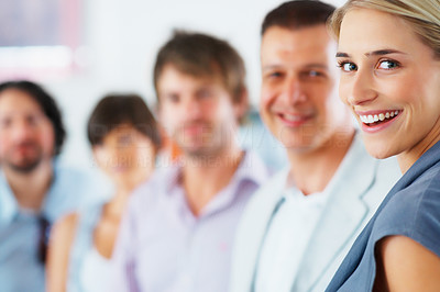 Buy stock photo Focus on smiling woman with team supporting her