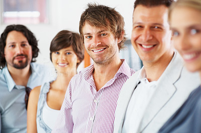 Buy stock photo View of team in row with focus on young man