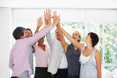 Buy stock photo Business people congratulating each other with high five