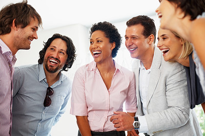 Buy stock photo Group of business people having friendly chat in the office