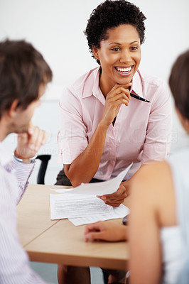 Buy stock photo Professional consultant discussing investment plan with young couple