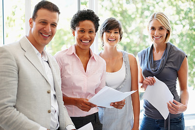 Buy stock photo Business people holding document in hand and smiling