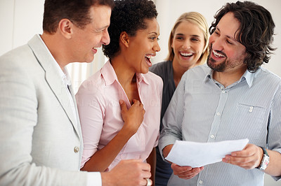 Buy stock photo Team of young business people laughing together in the office