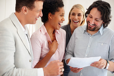 Buy stock photo Smiling young business man holding project with his team