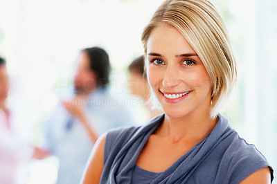 Buy stock photo Closeup of pretty woman with colleagues talking in background