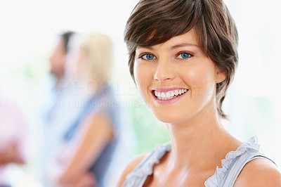 Buy stock photo Pretty woman smiling with group in background