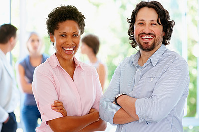 Buy stock photo View of man and woman laughing while rest of group is in background
