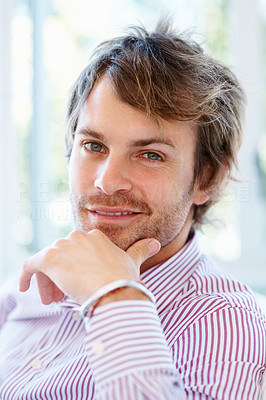 Buy stock photo Man resting chin on hand while looking directly at you