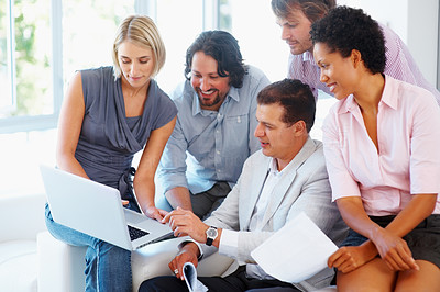 Buy stock photo Corporate professionals smiling and working together in the office