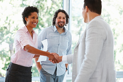 Buy stock photo Business woman shaking hands with male partner in the office