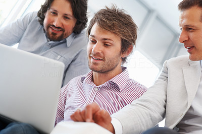 Buy stock photo Young business man working on laptop with team in the office