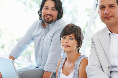 Buy stock photo Beautiful business woman with her team using laptop at office