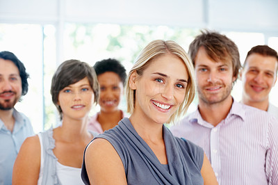 Buy stock photo Happy young business woman with her team in background