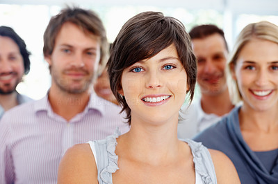 Buy stock photo Beautiful business woman with colleagues in background