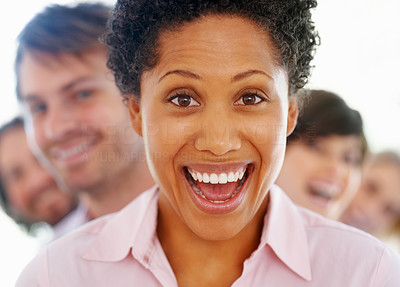 Buy stock photo Closeup of young business woman laughing with colleagues in background