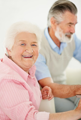 Buy stock photo Portrait of a happy elderly couple sitting at home