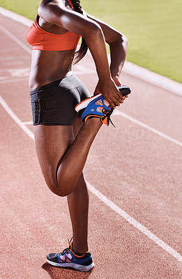 Stretching thoroughly before a race
