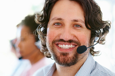Buy stock photo Closeup portrait of young male executive wearing headset and smiling