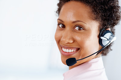 Buy stock photo Closeup of young female executive wearing headset and smiling