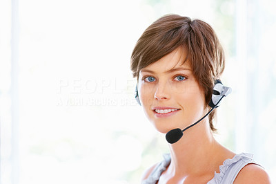 Buy stock photo Young female executive wearing headset and smiling at office