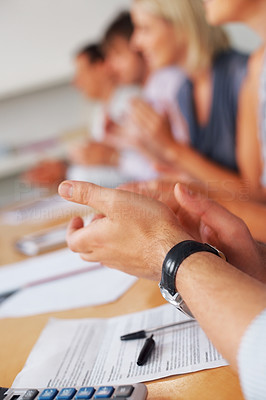 Buy stock photo Cropped view of business team clapping hands in meeting