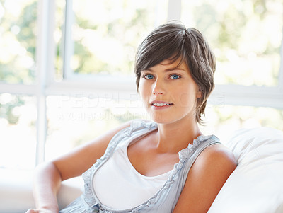 Buy stock photo Beautiful young woman relaxing on sofa at home