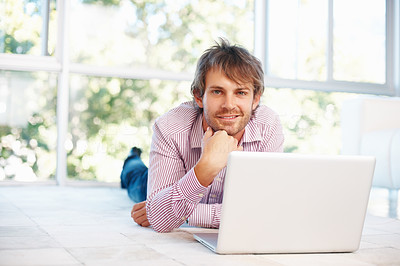 Buy stock photo Successful happy business man lying down on floor and  using laptop