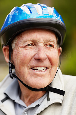 Buy stock photo Closeup portrait of a happy mature man wearing bicycle helmet
