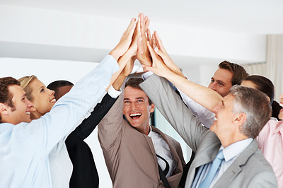 Buy stock photo Excited group of business people celebrating success with high five