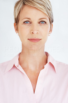 Buy stock photo Portrait of a smart female business executive looking confidently