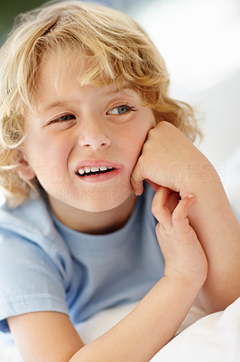 Buy stock photo Closeup portrait of a thoughtful boy with his hands on chin