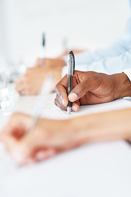 Buy stock photo Closeup of a business people hands writing note during meeting