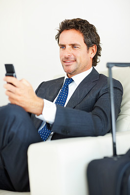 Smart business man reading text message