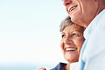Mature couple smiling against sky