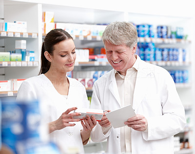 Smiling professionals checking the medicine