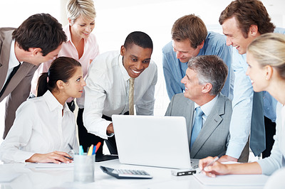 Buy stock photo Portrait of a team of happy office people working on laptop computer and smiling